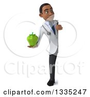 Clipart Of A 3d Full Length Young Black Male Nutritionist Doctor Holding A Green Bell Pepper And Looking Around A Sign Royalty Free Illustration