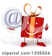 Clipart Of A 3d Happy Red Gift Character Giving A Thumb Up And Holding An Email Arobase At Symbol Royalty Free Illustration by Julos