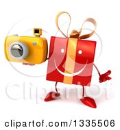 Clipart Of A 3d Happy Red Gift Character Shrugging And Holding A Camera Royalty Free Illustration by Julos