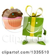 Clipart Of A 3d Happy Green Gift Character Holding A Chocolate Frosted Cupcake Royalty Free Illustration