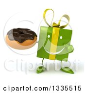 Clipart Of A 3d Happy Green Gift Character Holding And Pointing To A Chocolate Frosted Donut Royalty Free Illustration