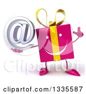 Clipart Of A 3d Happy Pink Gift Character Holding Up A Finger And An Email Arobase At Symbol Royalty Free Illustration by Julos