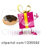 Clipart Of A 3d Happy Pink Gift Character Holding Up A Finger And A Chocolate Frosted Donut Royalty Free Illustration by Julos
