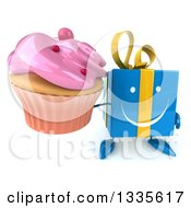 Clipart Of A 3d Happy Blue Gift Character Holding Up A Pink Frosted Cupcake Royalty Free Illustration by Julos