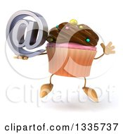 Clipart Of A 3d Chocolate Frosted Cupcake Character Jumping And Holding An Email Arobase At Symbol Royalty Free Illustration