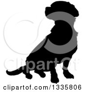 Clipart Of A Black Silhouetted Mixed Breed Puppy Dog Sitting Royalty Free Vector Illustration by Maria Bell