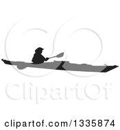 Black Silhouetted Man Kayaking