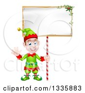 Clipart Of A Cartoon Happy Male Christmas Elf Waving And Holding A Blank Sign Royalty Free Vector Illustration