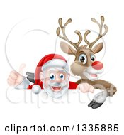 Clipart Of A Cartoon Christmas Red Nosed Reindeer And Santa Giving A Thumb Up Above A Sign Royalty Free Vector Illustration