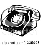 Clipart Of A Retro Woodcut Black And White Rotary Landline Desk Telephone Royalty Free Vector Illustration