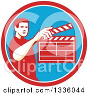 Clipart Of A Retro Male Movie Director Holding Up A Clapperboard In A Red White And Blue Circle Royalty Free Vector Illustration