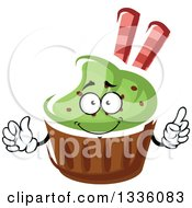 Clipart Of A Cartoon Green Frosted Cupcake Character Giving A Thumb Up Royalty Free Vector Illustration
