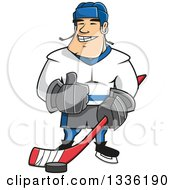 Clipart Of A Cartoon White Male Ice Hockey Player Giving A Thumb Up Royalty Free Vector Illustration