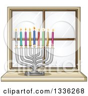 Silver Hanukkah Menorah Lamp With Colorful Candles On The Inside Of A Window