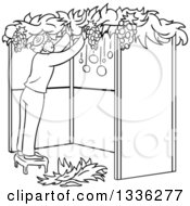 Clipart Of A Cartoon Black And White Jewish Man Standing On A Stool And Building A Sukkah For Sukkot Royalty Free Vector Illustration by Liron Peer
