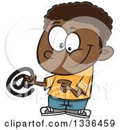 Cartoon Black Boy Holding An Email Arobase At Symbol