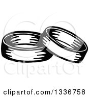 Clipart Of A Sketched Doodle Of Black And White Wedding Bands Royalty Free Vector Illustration by Prawny