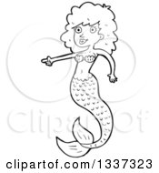 Lineart Clipart Of A Cartoon Black And White Mermaid Pointing Royalty Free Outline Vector Illustration by lineartestpilot