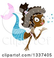 Clipart Of A Textured Black Mermaid Blowing A Kiss Royalty Free Vector Illustration
