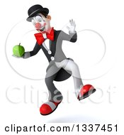 Clipart Of A 3d White And Black Clown Holding A Green Apple And Jumping Royalty Free Illustration
