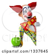 Clipart Of A 3d Funky Clown Holding A Green Apple And Looking Around A Sign Royalty Free Illustration