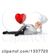 Clipart Of A 3d Young White Male Chef Holding A Red Love Heart And Resting On His Side Royalty Free Illustration