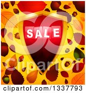 Clipart Of A 3d Red And Gold Sale Shield Over Autumn Leaves And Orange Royalty Free Vector Illustration by elaineitalia