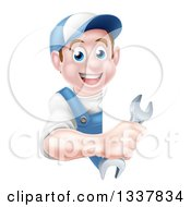 Clipart Of A Happy Young Brunette Caucasian Mechanic Man In Blue Wearing A Baseball Cap Holding A Wrench Around A Sign Royalty Free Vector Illustration