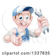 Clipart Of A Happy Young Brunette Caucasian Mechanic Man In Blue Wearing A Baseball Cap Holding A Wrench And Thumb Up Royalty Free Vector Illustration