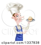 Clipart Of A Snooty White Male Chef With A Curling Mustache Holding A Cupcake On A Tray And Pointing To The Right Royalty Free Vector Illustration