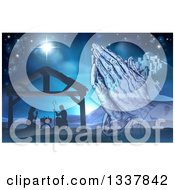 Clipart Of A Engraved Praying Hands Over A Silhouetted Christmas Nativity Scene At The Manger With The Star Of Bethlehem And City In Blue Tones Royalty Free Vector Illustration by AtStockIllustration