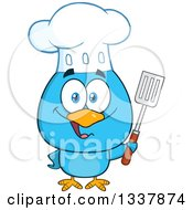 Clipart Of A Cartoon Happy Chef Blue Bird Holding A Slotted Spatula Royalty Free Vector Illustration
