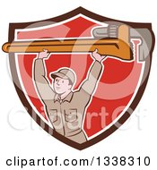 Clipart Of A Retro Cartoon White Male Plumber Holding A Giant Monkey Wrench Over His Head Emerging From A Brown White And Red Shield Royalty Free Vector Illustration