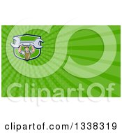 Clipart Of A Cartoon White Male Mechanic Holding Up A Giant Wrench In A Shield And Green Rays Background Or Business Card Design Royalty Free Illustration