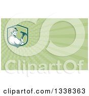 Clipart Of A Retro Male Demolition Worker Holding A Sledgehammer In A Shield And Green Rays Background Or Business Card Design Royalty Free Illustration by patrimonio
