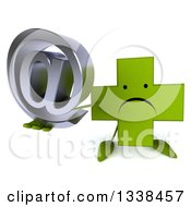 Clipart Of A 3d Unhappy Green Naturopathic Cross Character Holding Up An Email Arobase At Symbol Royalty Free Illustration