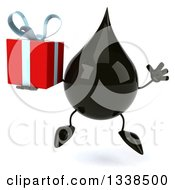 Clipart Of A 3d Oil Drop Character Jumping And Holding A Gift Royalty Free Illustration