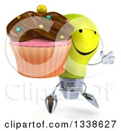 Clipart Of A 3d Happy Yellow Light Bulb Character Facing Slightly Right Jumping And Holding A Chocolate Frosted Cupcake Royalty Free Illustration