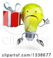 Clipart Of A 3d Unhappy Yellow Light Bulb Character Jumping And Holding A Gift Royalty Free Illustration