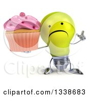 Clipart Of A 3d Unhappy Yellow Light Bulb Character Holding Up A Finger And A Pink Frosted Cupcake Royalty Free Illustration