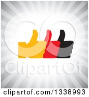 Clipart Of Three Silhouetted Thumbs Up Like App Icon Design Element Over Gray Rays Royalty Free Vector Illustration by ColorMagic