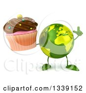 Clipart Of A 3d Green Earth Character Holding Up A Finger And A Chocolate Frosted Cupcake Royalty Free Illustration
