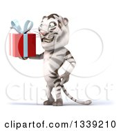 Clipart Of A 3d White Tiger Facing Left And Holding A Gift Royalty Free Illustration