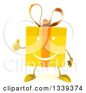 Clipart Of A 3d Yellow Gift Character Giving A Thumb Up Royalty Free Illustration by Julos