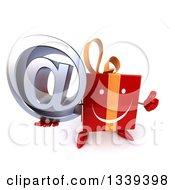 Clipart Of A 3d Happy Red Gift Character Holding Up A Thumb And An Email Arobase At Symbol Royalty Free Illustration by Julos