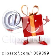 Clipart Of A 3d Happy Red Gift Character Holding Up A Finger And An Email Arobase At Symbol Royalty Free Illustration by Julos