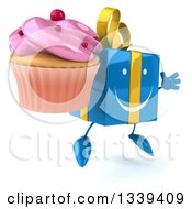 Clipart Of A 3d Happy Blue Gift Character Facing Slightly Right Jumping And Holding A Pink Frosted Cupcake Royalty Free Illustration by Julos