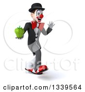 Clipart Of A 3d White And Black Clown Holding A Green Bell Pepper Walking And Waving To The Right Royalty Free Illustration