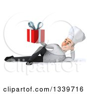 Clipart Of A 3d Young White Male Chef Holding A Gift And Resting On His Side Royalty Free Illustration