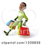 Clipart Of A 3d Young Black Male Super Hero In A Green Suit Carrying Shopping Bags And Speed Walking To The Left Royalty Free Illustration
